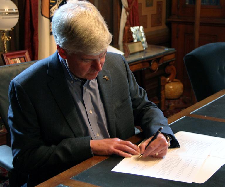 Gov. Synder Signing a Michigan Marijuana Law info effect